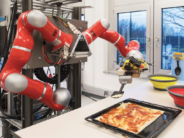 Cobots in action at a food processing unit.